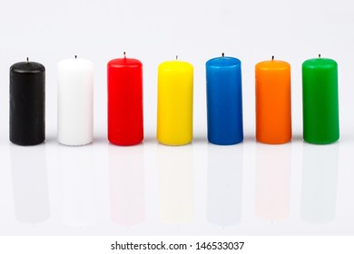 seven colored candles on a white background