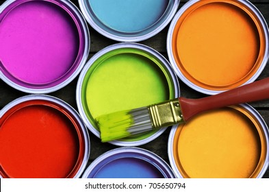 Seven colorful paint with a brush
