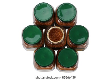 Seven glass jars coffee granules isolated on a white background