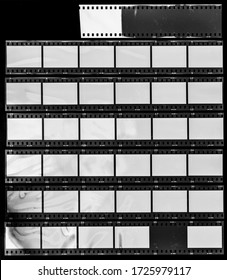 Seven long and empty 35mm filmstrips on black background.