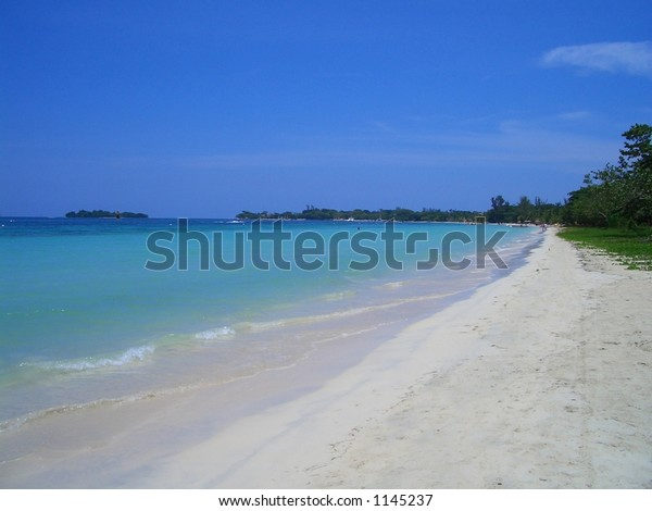 SEVEN MILE BEACH.This Photograph was taken on the Negril coast of west Jamaica, Caribbean, West Indies. On 6th August 2004 as Jamaica celebrated its 42nd Independence day.