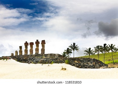 Seven moais standing on the Anakena Beach in Easter Island facing inland