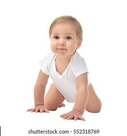 Seven month Infant child baby girl in diaper sitting happy smiling isolated on a white background