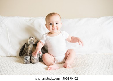 Seven month old baby sits for portrait