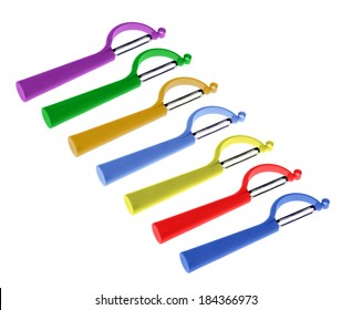 seven peelers, different colors, arranged in arrow