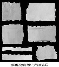 Seven pieces of torn newspaper on black background