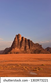 The Seven Pillars of Wisdom with blue sky background.Large rock formation, with seven fluted turrets.Red Wadi Rum desert.Dream destination for traveller.Concept about great journey.Valley of the Moon.