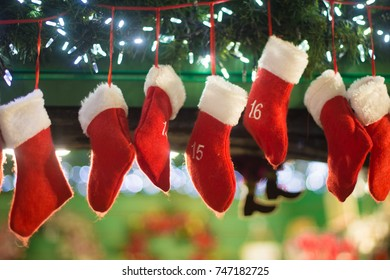 seven red and white christmas stockings hanging up on xmas eve - Xmas Stockings