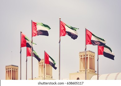 Seven United Arab Emirates flags, color toning applied, Sharjah, United Arab Emirates.