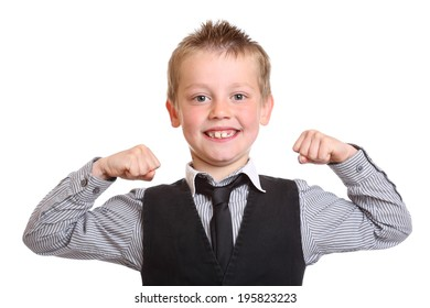 Seven year old boy acting like a strongman