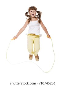 Seven years Girl jumping with skipping rope isolated on white