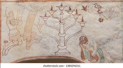 A seven-branched candelabrum, the Menorah, is the national symbol of Israel, a 500 years old gotic mural in Tirsted church, Denmark, April 17, 2019