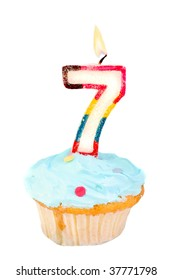 seventh birthday cupcake with blue frosting on a white background