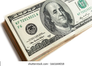 Several 100 dollar bills close up. American currency, cash. Pack of US dollars on white background.