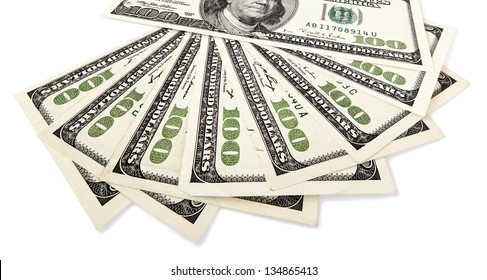 Several 100 US$ money notes spread out in fan shape, isolated on white background.