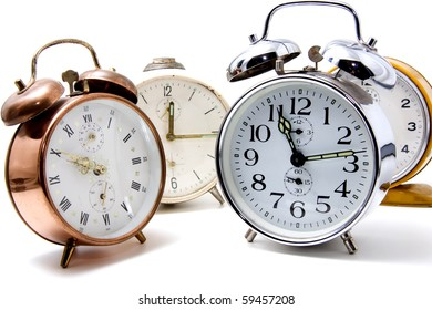 several alarm clocks over white background