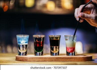 Several alcohol shot glasses.Shots on a bar counter top. Set of shot cocktails.