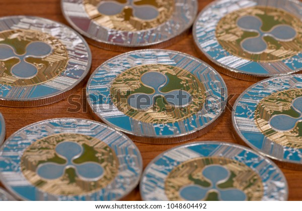 several aligned ripple coins on top of wooden table.