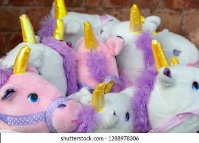 several baby unicorns with gold horns all crushed together