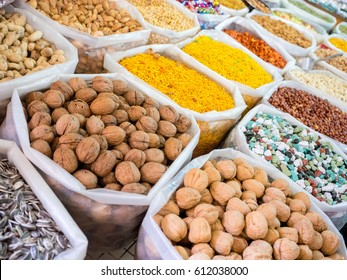 Several bags with colorful food and spices in a market souq at Nizwa, Oman
