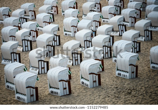 Several beach chairs sitting on the fine sand of the famous beach in Sellin, Germany