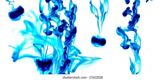 Several blue in splashes flowing on water. Isolated in white.