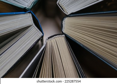 Several books stand together background