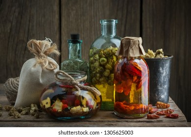 Several bottles of healing infusion or oil. Herbal medicine.