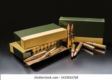 several boxes of ammunition for a carbine or rifle on a dark background