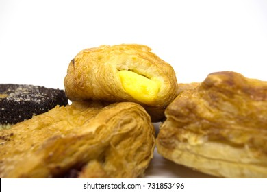Several breads on a white background.