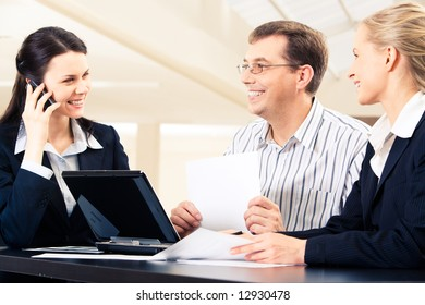 Several business partners sitting in the office and interacting  with each other