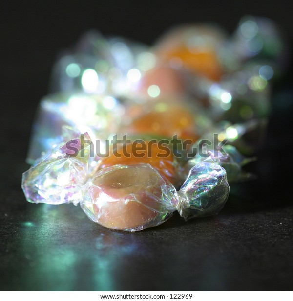 several candies wrapped in colorful cellophane wrappers