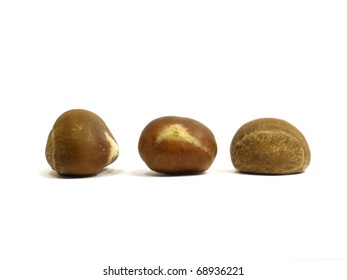 Several chestnuts isolated on white background
