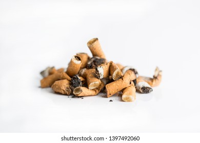 Several cigarette butts isolated on white background