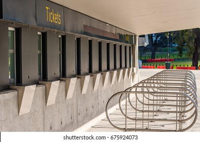 Several closed and empty ticket windows with metal handrails at a sports stadium in Melbourne, Victoria, Australia