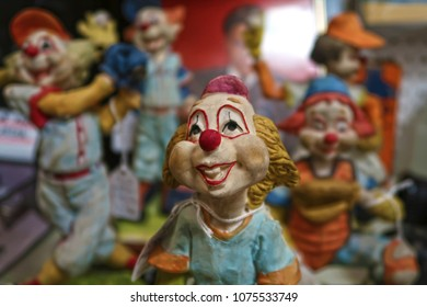 Several clown figurines with the focus being on the one in the front.