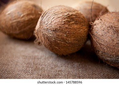 several coconuts on a gunny background