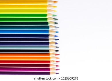 Several colored pencils on a white background with copy space
