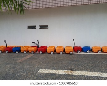 Several colorful carts, 4 in 4, forming a kind of small train, to be mobilized by adults, a different playground, made of plastic, sturdy and quite attractive.