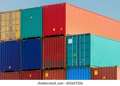Several colorful containers stacked in a port