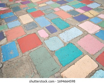 Several colorful paving stones in different sizes