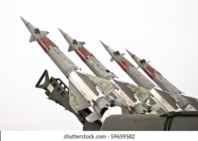 Several combat missiles aimed at the sky. Isolated on a white background. Missile weapons.