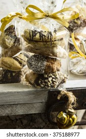 Several cookies in cellophane bag with golden ribbons
