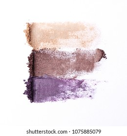 several cosmetic eye shadow shadows of different colors for the eyes on a white background. a palette of shadows. minimalism, procurement for design. top