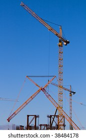several cranes on project