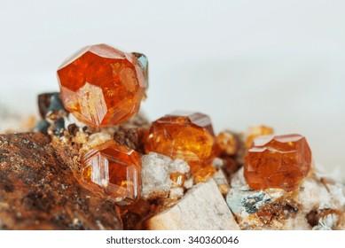 Several crystals of natural gemstone garnet Spessartite on matrix, collectable specimen from China