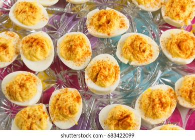 Several delicious Deviled Eggs topped with paprika