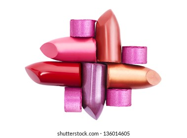Several different lipsticks isolated on white background