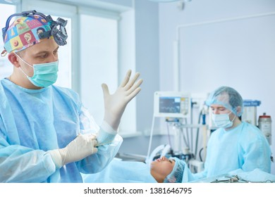 Several doctors surrounding patient on operation table during their work. Team surgeons at work in operating room