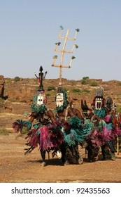 Several Dogon dancers with masks performing a ritual dance. Masks which may symbolize animals are sometimes traveling through several villages. Some masks are only used in a 60 year cycle.